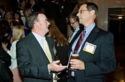 Engaged in conversation during the networking portion of the Boston Business Journal's Best Places to Work event was Tom Elcock of Prince Lobel and Bill Diana of Winter Wyman.