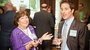 Gail Paul of Next Promotions and Robert Lorenson of Webster Bank chatting during the social hour at the Boston Business Journal 2012 Corporate Citizenship Summit.