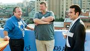 John Fantasia (left) of Re-Stream had the attention of Bill Osborn and Damien Morinon of BCM Controls Corp at the Boston Business Journal's 2012 End of Summer Party.