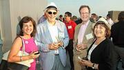 Enjoying the evening at the Boston Business Journal's 2012 End of Summer Party, held on the rooftop deck of the Revere Hotel, were, from left: Cathy Bazdanes of Randstad, Kenneth Reich of Kenneth Reich Law, and Next Level's Robert Rebholz and Gail Paul.