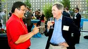 Literally making a point at the Boston Business Journal's 2012 End of Summer Party was Christophe Henares-Chuidian of ARC Document Solutions – to Joseph Hunter from Olin College of Engineering.