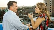 Taking in the cityscape from the Revere Hotel at the Boston Business Journal's 2012 End of Summer Party were Louie Comeau of Bryant Back Bay and Shannon Mills with RSIG Security.