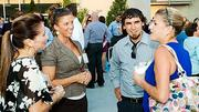 Networking at the Boston Business Journal's 2012 End of Summer Party were, from left: Emmanuel College's JoAnna Luiso, King Bowl of America's Samantha Beaugrand and Bryan Imberamo, and EngineRoom Edit's Lauren Azar.