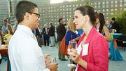 Ramon Flores of the Federal Reserve Bank of Boston and Cecilia Vernes of Longwood Lunch engage in conversation at the Boston Business Journal's 2012 End of Summer Party.