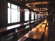 Harpoon kept the decor simple in its new beer hall: Heavy wood benches, long tables bolted to the floor, and big windows looking out on Boston's Inner Harbor.