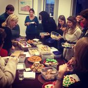 SM& employees show off their baking prowess at the firm's first annual holiday cookie swap.