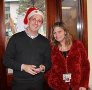 Leighton Jones, director of emergency services (left), at the American Red Cross of Eastern Massachusetts holiday party with Lisa Contee, a volunteer from Medford who just returned from two deployments in New York where she helped those affected by Superstorm Sandy.