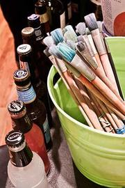 Bottles and brushes create their own still life at The PaintBar in Newton.