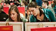Alison Kuhn and Marianna Fraone working intently on their art at The PaintBar in Newton, MA.
