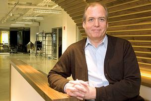 William Brah, executive director of the UMass Boston Venture Development Center, in its new digs.