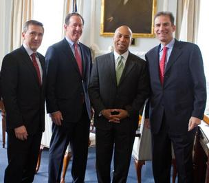 Gov. Deval Patrick and Entegris executives (left to right: Bertrand Loy, Entegris COO; Greg Graves, Entegris CFO; Gov. Patrick; and Gideon Argov, CEO) discuss the company's plans to invest $50M in a new R&D center.