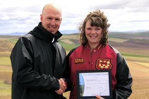 First Wind CEO Paul Gaynor and scholarship winner Heidi Jamison