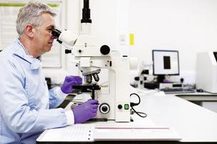 Scientists at AstraZeneca perform research at the company's lab.