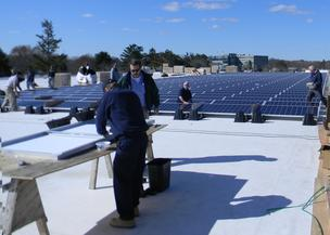 A new solar array recently installed on the West Garage of the Cummings Properties Campus.