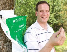 Jon Strimling, founder and CEO of American Biomass, holds in his hands a cheaper way to heat the home.
