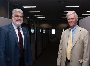 Mark Galvin, left, managing director of the new accelerator, and Mark Huddleston, president of UNH, plan to fill up the row of cubicles with tech startups.