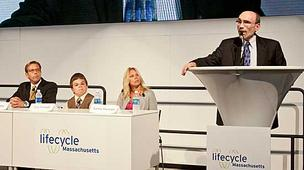 During a panel about biotech drugs Biogen Idec's Glenn Pierce, seen here at the podium, discussed his own experience with hemophilia.