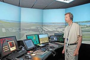 Simulators such as this one demonstrated by Douglas Corrigan of Adacel  at Logan Airport help to train air-traffic controllers and others without risking lives.