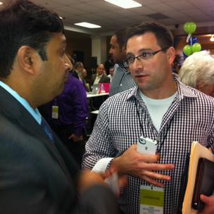 Adam Goldberg, founder of myEdGPS, talking to an attendee at the RNC.