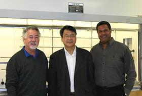 Warren Shore, founder and president of United States Biological Corp., left, with Ban-An Khaw, chief scientific officer and co-founder of Akrivis, and Joel Berniac, CEO and co-founder of Akrivis, right, in the companies' new lab space in Salem.
