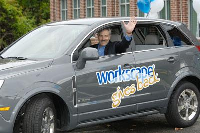 Workscape President and CEO Tim Clifford drives a Saturn hybrid launching the Workscape Gives Back road trip.