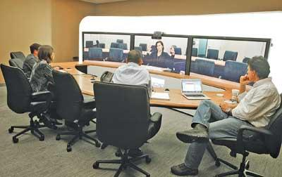 At the high end of the videoconferencing spectrum, telepresence is designed to give remote participants a feeling of being in the room.