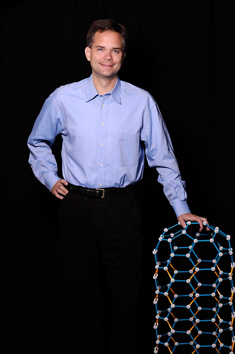 Nantero's co-founder and CEO Greg Schmergel with a model of a carbon nanotube