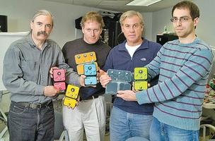 Source Audio LLC includes, from left, chief scientist Bob Chidlaw, president Roger Smith, CEO C. Hunter Boll and VP of engineering Jesse Remignanti, all holding the firm's musical effects devices controlled by a ring.