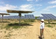 AllEarth Renewables' David Blittersdorf with some of his company's All Sun Tracker solar arrays.