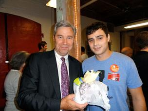 U.S. Sen. Sheldon Whitehouse accepts his falafel ordered by Crunchbutton co-founder Judd Rosenblatt.