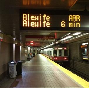 Photo of an LED sign as a Red Line train rolls into South Station