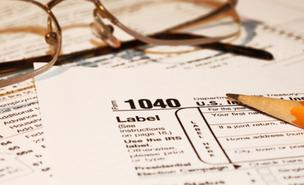 As many as 23,300 Massachusetts residents didn't file federal tax returns in 2009, and the IRS estimates they're owed $23 million.