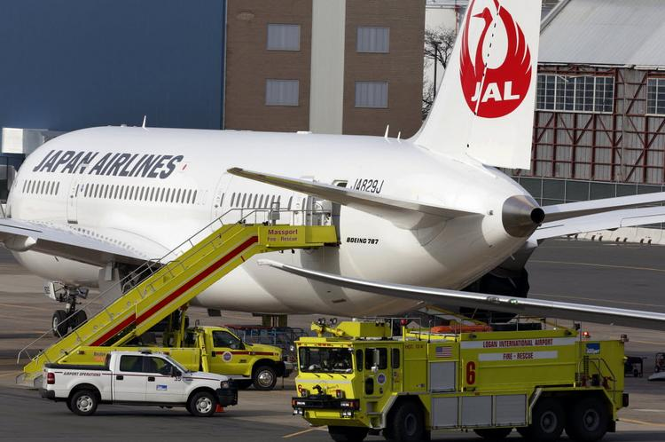 Boeing hopes to soon dispatch AOG teams to install battery fixes on Japan Airlines 787s like this one that suffered a battery fire at Boston's Logan Airport, if the FAA approves the Boeing plan.