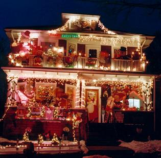 """Lenny """"Iggy"""" Rigione's house on Central Street is a staple of Somerville's Christmas lights trolley tour. The figurines are animated by windshield-wiper motors."""