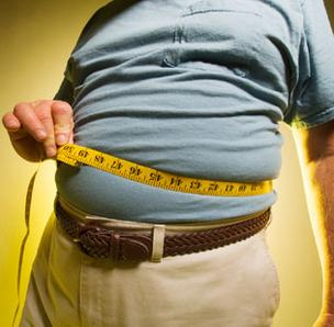 Overweight man with measuring tape