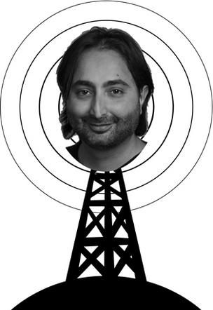 Head shot of Hemant Taneja atop a radio tower