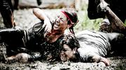 A muddy collision at a Spartan Race event.