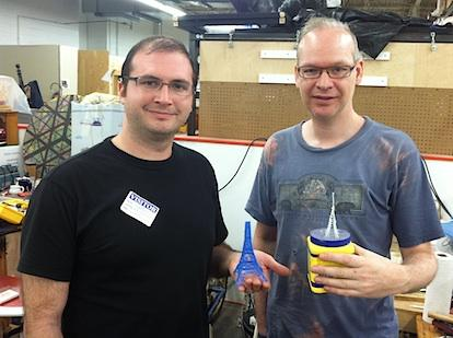 The co-founders of the 3Doodler, Max Bogue (left) and Peter Dilworth, at the Artisan's Asylum in Somerville. Bogue is holding a recent 3-doodle of the Eiffel Tower, while Dilworth is a version of the tower which was the first-ever 3-doodle.