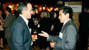 Greg O'Shaughnessy (left) of Nixon Peabody and chair of Inventors at the Museum of Science listens as Xavier Xicay of Tuatara makes a point while networking at Mass High Tech's and the Boston Business Journal's Innovation All Stars event held at the House of Blues.