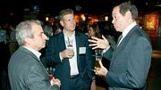 Listening with rapt attention to Bob Burke (right) of McGladrey were Dan Davis of Accounting Management Solutions and Chris LaDue also of McGladrey which was a presenting partner at Mass High Tech's and the Boston Business Journal's Innovation All Stars event held at the House of Blues.
