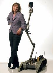 "CyPhy Works Maybe you've heard of Heartland Robotics, from iRobot co-founder Rodney Brooks. But have you heard about CyPhy Works, started by the ""other"" iRobot co-founder that left the company, Helen Greiner? The photo above is from Helen's iRobot days; we don't actually know what the CyPhy robots look like. What we do know is the Danvers-based startup is developing unmanned aerial vehicles for the Department of Defense and Department of Commerce, and has been backed by $1.2 million from backers including General Catalyst."