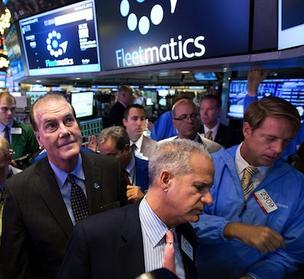 Fleetmatics CEO Jim Travers, left, visits the trading floor of the New York Stock Exchange Friday to witness the first trade of his company's stock.