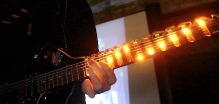 """Tabber, an LED light guitar for learning. From the team description: """"Tabber is an Arduino based LED system for your guitar. You control songs, scales, and chords through your mobile device while the correct notes light up on the neck of the guitar itself. It's primarily an educational tool, a visual and portable guitar teacher, but also can be used for light effects during performances."""" YouTube demo here"""
