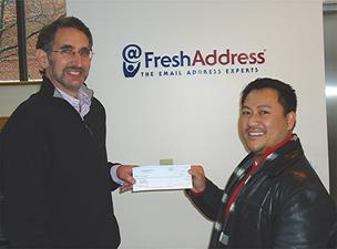 Alex Vongphakdy of Waltham, right, won $3,000 in a contest to guess when the 3 billionth email would be processed by FreshAddress. CEO Bill Kaplan is on the left.