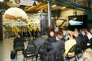 Textron Defense Systems Senior Vice President and General Manager Ian Walsh speaks to guests assembled to see the company's work on NASA's Orion spacecraft heat shield.