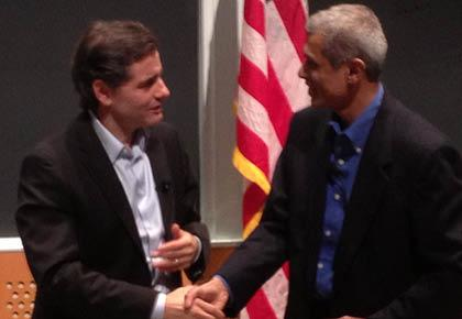 FCC Chairman Julius Genachowski, left, spoke at a lecture series sponsored by Wireless@MIT on Wednesday. He is shaking hands with professor Hari Balakrishnan, a co-director at the center.