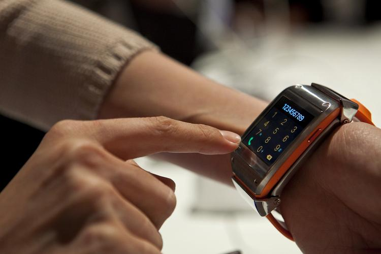 An attendee demonstrates the Samsung Electronics Co. Galaxy Gear after the unveiling ahead of the IFA consumer electronics show in Berlin, Germany, on Wednesday.