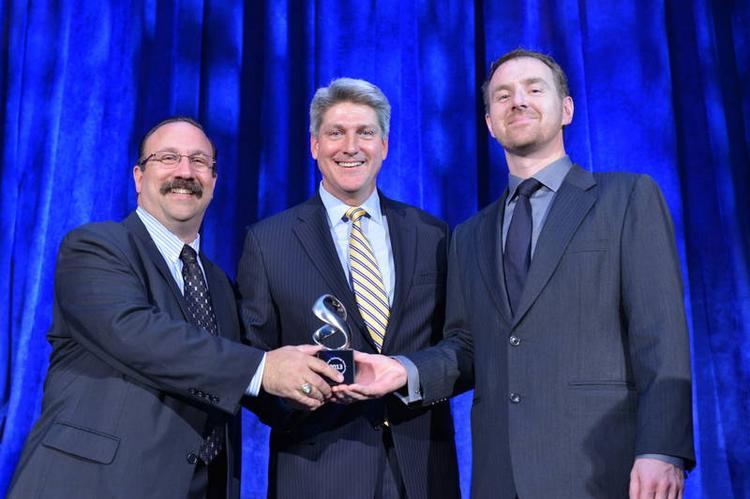 Vicor's Robert DeRobertis, director of corporate marketing and communications (left), and Stephen Oliver, vice president VI Chip product line (right), accepting the TechAmerica Foundation American Technology Award on June 20, 2013