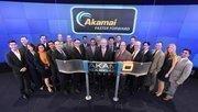 Executives at Akamai Technologies prepare to ring the Nasdaq bell to begin trading.