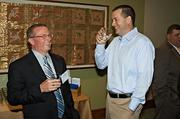 Rob Jones of EchoStor Technologies and Ethan Simmons of Simmons Consulting have a lighter moment at the Mass High Tech & Boston Business Journal's 2013 CIO of the Year awards breakfast.